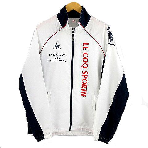 ルコックスポルティフ Le coq sportif ジャケット ナイロンジャケット トレーニングウェア ウインドブレーカー プリント ロゴ ホワイト 白 ネイビー 紺 レッド 赤 O メンズ